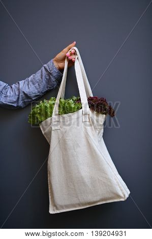 Linen Bag With Lettuce Salad In Woman Hand