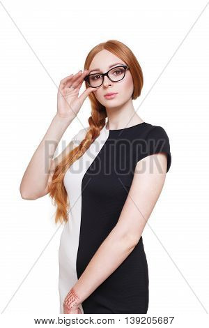 Redhead long-haired braided woman in eyeglasses. Young red ginger stylish girl in black and white dress. Beautiful attractive female portrait isolated at white background.
