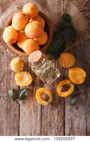 Apricot Kernel Oil In A Glass Jar Closeup And Ingredients. Vertical Top View