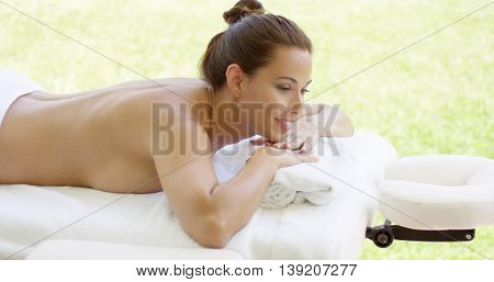 Naked woman relaxes on massage table