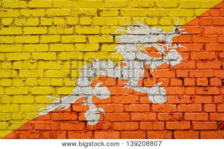 Flag of Bhutan painted on brick wall background texture