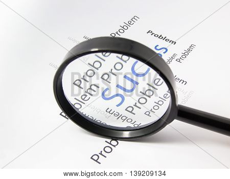 Magnifier on paper focus to success word