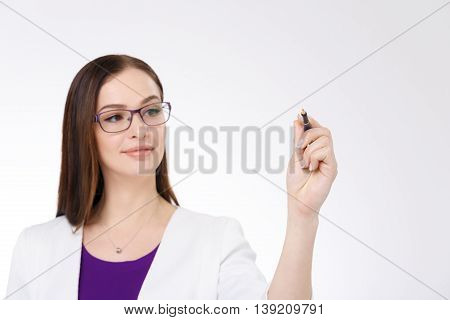 Attractive businesswoman writing with pen on white background