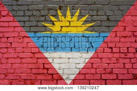 Flag of Antigua Barbuda painted on brick wall background texture