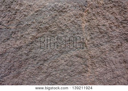 Background of the granite wall. Texture of the granite wall