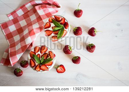 Layered Dessert Of Strawberries, Biscuit And Ice Cream In A Glass
