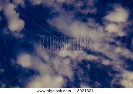 Cumulus Clouds Float Across The Blue Sky
