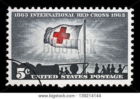ZAGREB, CROATIA - JULY 03: A stamp printed in USA, shows Morning Light and Red Cross Flag, International Red Cross Centenary 1963, circa 1963, on July 03, 2014, Zagreb, Croatia