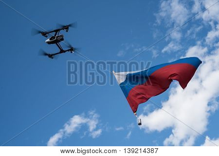 St. Petersburg Russia - June 4 2016: The Russian flag on a background of blue sky raised with the help of aircraft