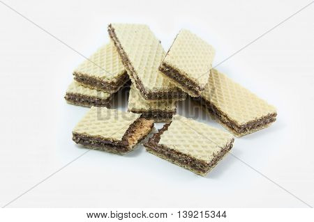 A chocolate wafer broken close up isolated