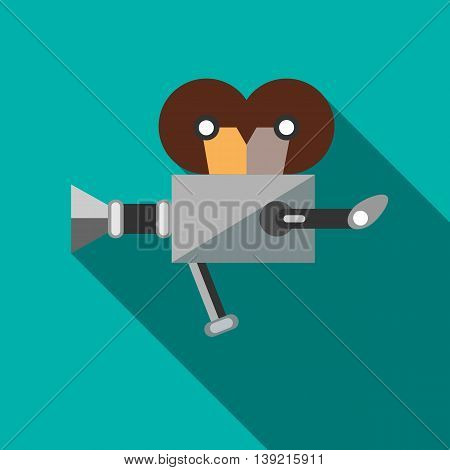 Retro cinema camera icon in flat style on a turquoise background