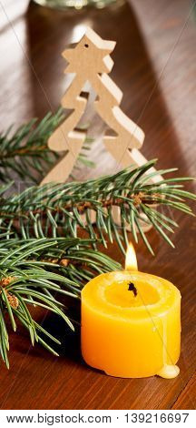 still life with christmas decoration and a candle