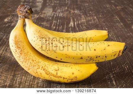 Bunch of fresh bananas on wooden tabl