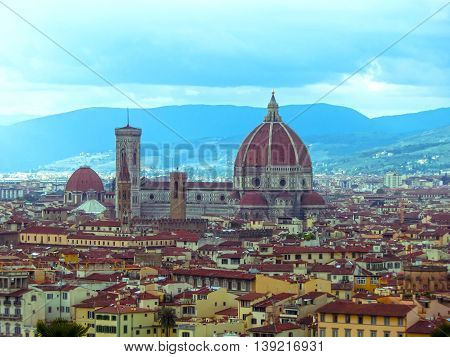 View of the Cathedral Santa Maria del Fiore in Florence, Italy - Florence's cathedral stands tall over the city with its magnificent Renaissance dome designed by Filippo Brunelleschi.