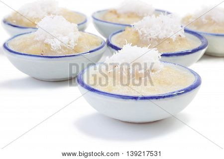 Right front cup steamed banana cake in cup on white floor.