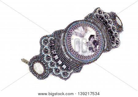 female jewelry handmade work. elegant bracelet isolated on white background