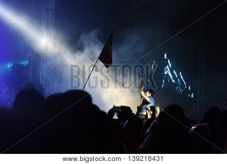 Guitarist Crowd Surfing During A Concert