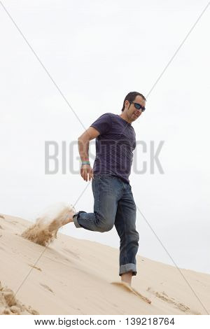 Happy Barefoot Man Going Down The Pilat Dune In France