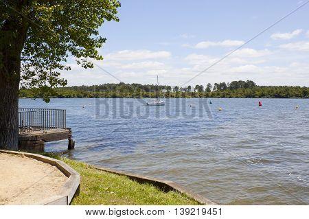 Sailing Boat In A Lake, Close To The Coast