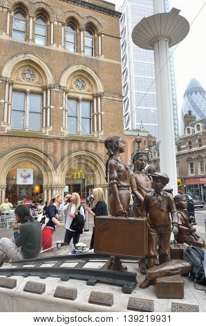 LIVERPOOL ST LONDON UK 16 September 2014: memorial in hope square with station in background
