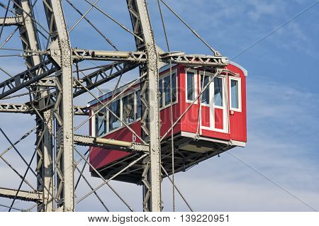 VIENNA, AUSTRIA, JULY 1,2016: Closeup detail of a hanging cabin from Wiener Riesenrad, a famous ferris wheel at the entrance of the Prater amusement park in Leopoldstadt.