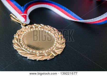 Golden Medal For First Place On Black Background.