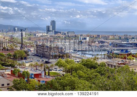 Barcelona Spain - April 21 2013: Panoramic of Barcelona Barcelona port area wadis and detail of the statue of Christopher Columbus