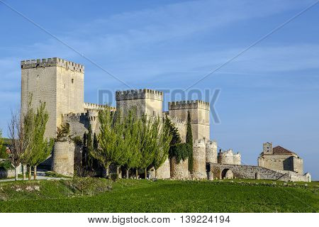 Castle and medieval church in Ampudia Palencia province Spain