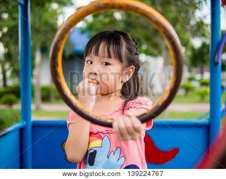 Happy kid asian baby child playing on playground