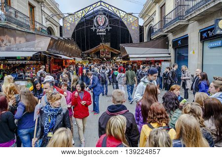 Barcelona Spain - March 30 2013: Tourists in famous La Boqueria market. One of the oldest markets in Europe that still exist. Established 1217.