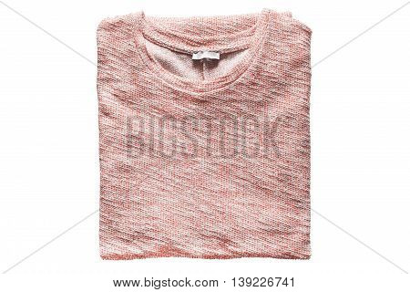Folded pink pullover isolated over white background