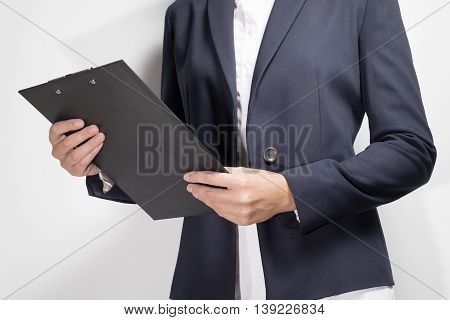 Businesswoman Holding A Clipboard