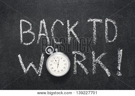 back to work phrase handwritten on chalkboard with vintage precise stopwatch used instead of O