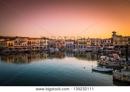 RETHYMNO, CRETE ISLAND, GREECE - JUNE 29, 2016: View of the old venetian port of Rethimno at sunset.