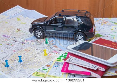 Plan your journey by car a passport money cards mobile phone.