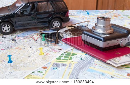 Plan your journey by car a passport money cards camera sunglasses.