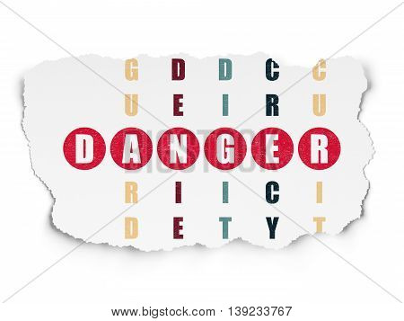 Security concept: Painted red word Danger in solving Crossword Puzzle on Torn Paper background