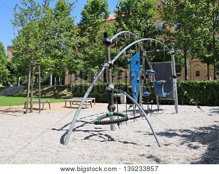 Playground in a city park with benches