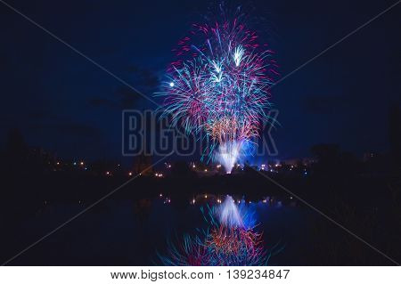 night traditional firework with reflection in water