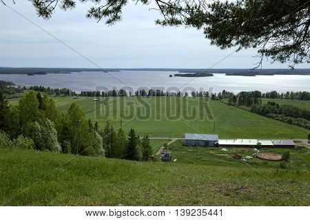 Outlook Over Agricultural Landscape And Lake At Stroemsund, Sweden
