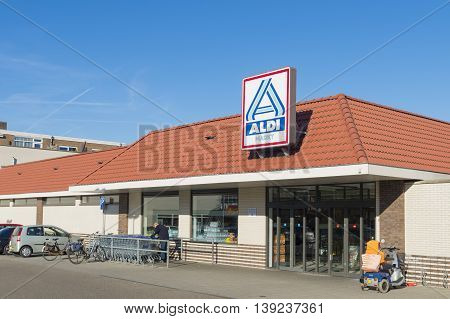 OLDENZAAL NETHERLANDS - NOVEMBER 3 2015: Aldi store exterior. Aldi is an internationally operating German chain of discount supermarkets founded in 1946 in Essen by the brothers Karl and Theo Albrecht