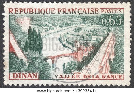 MOSCOW RUSSIA - CIRCA JANUARY 2016: a post stamp printed in FRANCE shows a view on the town of Dinan and river Rance the series