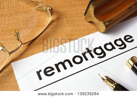 Page of paper with remortgage on a table.