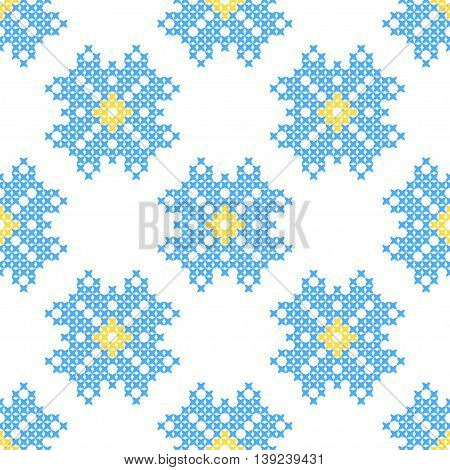 Seamless embroidered texture of abstract flat patterns cornflowers cross-stitch ornament for cloth