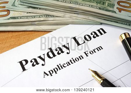 Payday loan form on a wooden table.