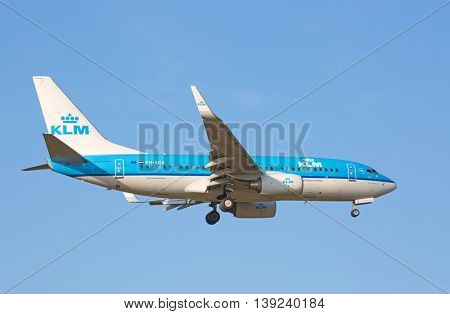 ZURICH - JULY 18: Boeing-737 KLM landing in Zurich after short haul flight on July 18, 2015 in Zurich, Switzerland. Zurich airport is one of biggest european hubs.