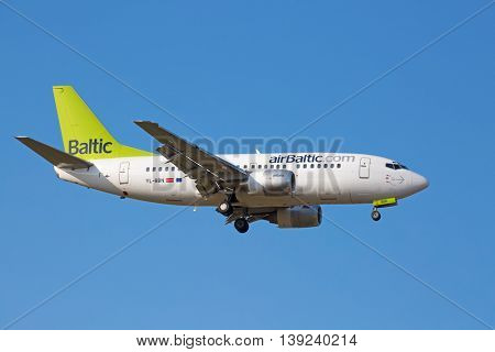 ZURICH - JULY 18: Boeing-737 Air Baltic landing in Zurich after short haul flight on July 18, 2015 in Zurich, Switzerland. Zurich airport is one of biggest european hubs.