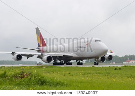 MOSCOW, RUSSIA - MAY 19, 2016: cargo airplane Boeing 747 Asiana Cargo taxiing to the runway at Domodedovo International airport.