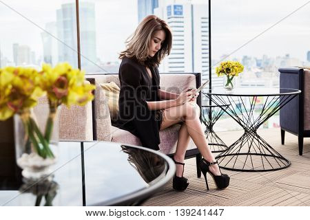 Pretty businesswoman using tablet stock watch location public.