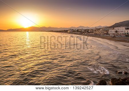 sunset on the beach of Sperlonga with the Circeo promontory in the background Italy